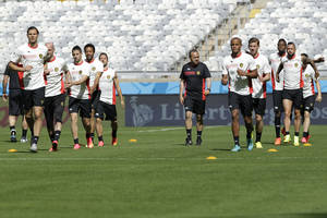 Photo - Belgium head coach Marc Wilmots walks between his players during a training session at the Mineirao Stadium in Belo Horizonte, Brazil, Monday, June 16, 2014.  Belgium will play in group H of the Brazil 2014 soccer World Cup.  (AP Photo/Bruno Magalhaes)