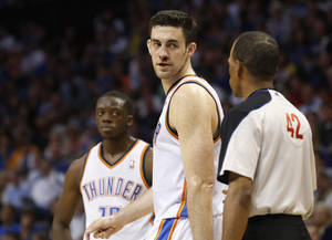 Photo - Oklahoma City Thunder forward Nick Collison, center, talks to official Eric Lewis (42) in the fourth quarter of an NBA basketball game against the New York Knicks in Oklahoma City, Sunday, April 7, 2013. New York won 125-120. (AP Photo/Sue Ogrocki) ORG XMIT: OKSO108