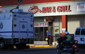 Photo -   Police are pictured at Fero's Bar and Grill in Denver on Wednesday, Oct. 17, 2012, where the bodies of a man and four woman were discovered after firefighters extinguished a fire at the bar early Wednesday morning.(AP Photo/Ed Andrieski)