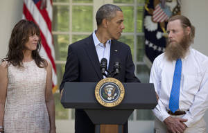Photo - President Barack Obama looks to Bob Bergdahl as Jani Bergdahl, stands at left, during a news conference in the Rose Garden of the White House in Washington on Saturday, May 31, 2014 about the release of their son, U.S. Army Sgt. Bowe Bergdahl. Bergdahl, 28, had been held prisoner by the Taliban since June 30, 2009. He was handed over to U.S. special forces by the Taliban in exchange for the release of five Afghan detainees held by the United States. (AP Photo/Carolyn Kaster)