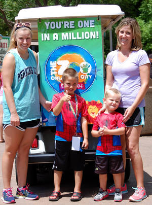Photo -  Megan Tracy, right, and sons Cadon, second from left, and Cason Tracy and cousin Courtlyn Elkins, left, helped set an attendance record for the Oklahoma City Zoo this fiscal year. PHOTO PROVIDED BY OKLAHOMA CITY ZOO  <strong>PROVIDED</strong>
