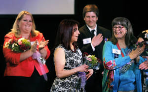 Photo - Heather Meldrum is announced Thursday as Oklahoma City Public Schools Teacher of the Year at Will Rogers Theatre in Oklahoma City.  Photo by Sarah Phipps, The Oklahoman