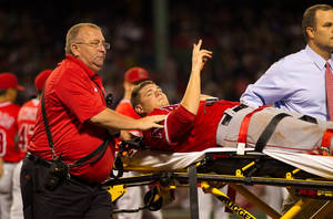 Photo - BOSTON, MA - AUGUST 20: Garrett Richards #43 of the Los Angeles Angels of Anaheim signals to the fans after he suffered a leg injury against the Boston Red Sox and is carried off the field on a stretcher during the second inning at Fenway Park on August 20, 2014 in Boston, Massachusetts. (Photo by Rich Gagnon/Getty Images) *** BESTPIX *** ** OUTS - ELSENT, FPG - OUTS * NM, PH, VA if sourced by CT, LA or MoD **