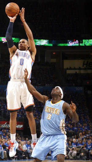 Photo - Oklahoma City's Russell Westbrook (0) shoots in over Denver's Ty Lawson (3) during the first round NBA basketball playoff game between the Oklahoma City Thunder and the Denver Nuggets on Wednesday, April 20, 2011, at the Oklahoma City Arena. Photo by Sarah Phipps, The Oklahoman