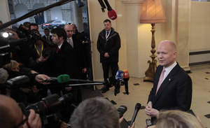 Photo - United Kingdom's Foreign Secretary William Hague speaks to the media on arrival for the European Informal Meeting of Ministers for Foreign Affairs at Dublin Castle, Ireland, Friday, March 22, 2013.  (AP Photo/Peter Morrison)