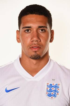Photo - RIO DE JANEIRO, BRAZIL - JUNE 08:  Chris Smalling of England poses during the official FIFA World Cup 2014 portrait session on June 8, 2014 in Rio de Janeiro, Brazil.  (Photo by Mike Hewitt - FIFA/FIFA via Getty Images)