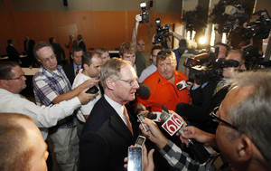 Photo - OSU: Oklahoma State University President Burns Hargis, talks with the media following the Board of Regents meeting in Stillwater, Tuesday, September 21, 2011. Photo by Steve Gooch  ORG XMIT: KOD