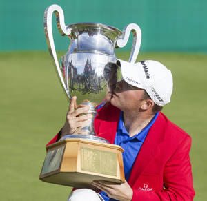Photo -   Richie Ramsay of Scotland kisses the winner's trophy after winning the Omega European Masters Golf Tournament in Crans Montana, Switzerland, Sunday, Sept. 2, 2012. (AP Photo/Keystone, Peter Klaunzer)