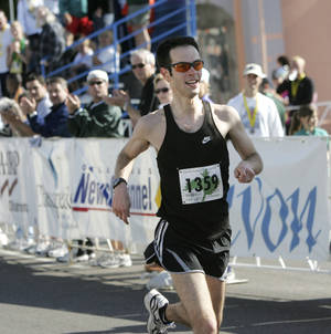 Photo - Adam Cohen runs the final stretch of the sixth annual Oklahoma City Memorial Marathon in 2006.  The Oklahoman file photo <strong>John Clanton -   </strong>
