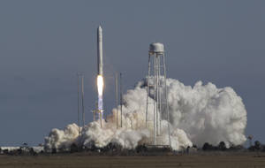 Photo - Orbital Sciences Corp.'s Antares rocket lifts off from the NASA facility on Wallops Island, Va., Sunday, April 21, 2013. The rocket will eventually deliver supplies to the International Space Station. (AP Photo/Steve Helber)
