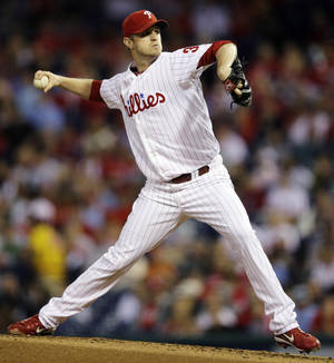 Photo -   Philadelphia Phillies' Kyle Kendrick pitches in the second inning of a baseball game against the Miami Marlins, Monday, Sept. 10, 2012, in Philadelphia. (AP Photo/Matt Slocum)