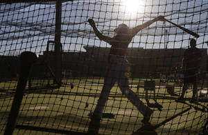 Photo - Arizona Diamondbacks first baseman Paul Goldschmidt hits during spring training baseball practice Wednesday, Feb. 12, 2014, in Scottsdale, Ariz.  (AP Photo/Gregory Bull)