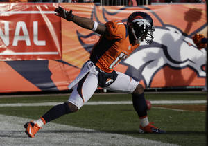 photo - Denver Broncos wide receiver Trindon Holliday celebrates after running a punt return back 90 yards for a touchdown against the Baltimore Ravens in the first quarter of an AFC divisional playoff NFL football game, Saturday, Jan. 12, 2013, in Denver. (AP Photo/Joe Mahoney)