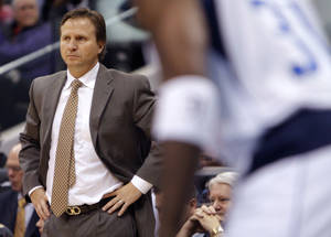 Photo - DALLAS MAVERICKS / NBA BASKETBALL: Oklahoma City's Scott Brooks watches the game during the preseason NBA game between the Dallas Mavericks and the Oklahoma City Thunder at the American Airlines Center in Dallas, Sunday, Dec. 18, 2011. Photo by Sarah Phipps, The Oklahoman