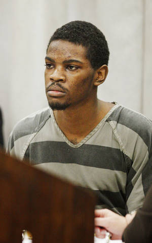 photo - Lester Kinchion sitting in the courtroom during his preliminary hearing at the Oklahoma County Courthouse in Oklahoma City Friday, Oct. 26, 2012. Kinchion is charged with first-degree murder in the May 18 shooting death of parole officer Jeffery Matthew McCoy, 32, of Norman, outside a Midwest City residence. Photo by Paul B. Southerland, The Oklahoman