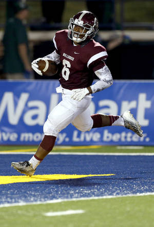 Photo - Edmond Memorial's Warren Wand scores a touchdown during the high school football game between Edmond Santa Fe and Edmond Memorial at Wantland Stadium in Edmond, Okla., Friday, Sept. 26, 2014. Photo by Sarah Phipps, The Oklahoman
