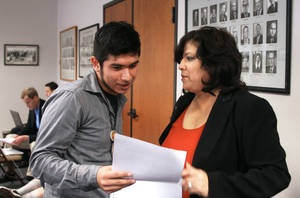 photo - University of Texas student Roberto Flotte, left, and state Rep. Norma Chavez, D-El Paso, talk after Chavez asked the State Board of Education to require curricula including more Hispanic figures at a hearing on new social studies curriculum standards on Wednesday in Austin, Texas. AP Photo