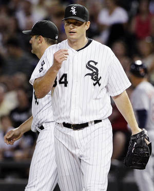 photo -   Chicago White Sox starter Gavin Floyd reacts after Detroit Tigers' Miguel Cabrera hit a single during the first inning of a baseball game in Chicago, Wednesday, Sept. 12, 2012. (AP Photo/Nam Y. Huh)
