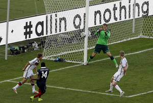 Photo - Germany's goalkeeper Manuel Neuer, second from right, makes a save after a shot by France's Blaise Matuidi, second from left, during the World Cup quarterfinal soccer match between Germany and France at the Maracana Stadium in Rio de Janeiro, Brazil, Friday, July 4, 2014. (AP Photo/Thanassis Stavrakis)