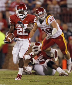 Photo - Oklahoma's Roy Finch (22) breaks a run into the Iowa State secondary during the first half of the college football game between the University of Oklahoma Sooners (OU) and the Iowa State Cyclones (ISU) at the Glaylord Family-Oklahoma Memorial Stadium on Saturday, Oct. 16, 2010, in Norman, Okla.  Photo by Chris Landsberger, The Oklahoman