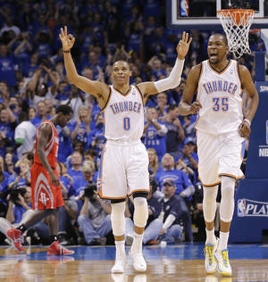 Photo - Oklahoma City's Russell Westbrook and Kevin Durant react Wednesday night after a 3-pointer by Kevin Martin during Game 2 in the first round of the NBA Playoffs between the Thunder and the Houston Rockets at Chesapeake Energy Arena in Oklahoma City. Photo by Chris Landsberger, The Oklahoman