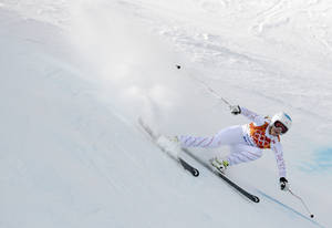 Photo - United States' Julia Mancuso makes a turn during the downhill portion of the women's supercombined at the Sochi 2014 Winter Olympics, Monday, Feb. 10, 2014, in Krasnaya Polyana, Russia. (AP Photo/Charles Krupa)