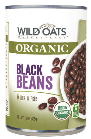 Photo - This product image provided Wal-Mart shows Wild Oats organic black beans. The world's largest retailer on Thursday, April 10, 2014 said that it has teamed up with Wild Oats to sell a new line of organic foods, starting this month, that's at least 25 percent cheaper than the national organic brands it carries and in line with the prices of its branded non-organic alternatives. Wild Oats helped pioneer the organic food trend in the late 1980s but has largely disappeared from store shelves since 2007. (AP Photo/Wal-Mart)