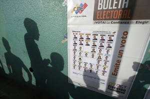 Photo -   Voters' shadows are cast on a wall as they wait at a polling station during the presidential election in Caracas, Venezuela, Sunday, Oct. 7, 2012. President Hugo Chavez is running against opposition candidate Henrique Capriles. (AP Photo/Fernando Llano)