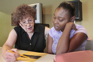 Photo - Instructor Kay Walls works with Tina Roberts, a student in a TANF basic skills class in literacy and math through Community Literacy Centers and DHS, at Britton Christian Church. Photo By David McDaniel, The Oklahoman <strong>David McDaniel</strong>