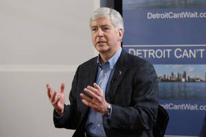 Photo - Gov. Rick Snyder declares a financial emergency during a broadcast in Detroit, Friday, March 1, 2013. The determination could lead to the appointment of an emergency manager over the city's finances. (AP Photo/Paul Sancya)