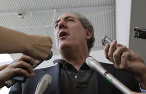Photo - U.S. Trade Representative Michael Froman speaks to journalists upon his arrival at Narita International Airport in Narita, east of Tokyo, Tuesday, April 8, 2014. Froman's visit is expected for talks with his Japanese counterpart on a Pacific free trade pact. (AP Photo/Shizuo Kambayashi)