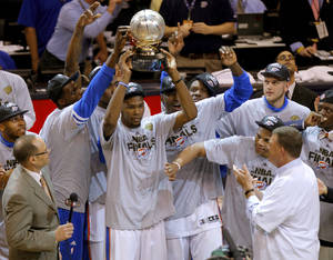 photo - Oklahoma City's Kevin Durant holds the Western Conference trophy beside Nazr Mohammed, left, Kendrick Perkins, Serge Ibaka, Royal Ivey, Russell Westbrook, Cole Aldrich and Reggie Jackson after Game 6 of the Western Conference Finals between the Oklahoma City Thunder and the San Antonio Spurs in the NBA playoffs at the Chesapeake Energy Arena in Oklahoma City, Wednesday, June 6, 2012. Oklahoma City won 107-99. Photo by Bryan Terry, The Oklahoman