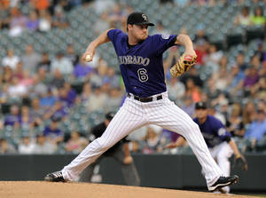 Photo -   Colorado Rockies starting pitcher Alex White throws during the first inning of a baseball game against the San Francisco Giants in Denver on Monday, Sept. 10, 2012. (AP Photo/Chris Schneider)