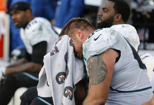 Photo - Jacksonville Jaguars center Brad Meester, front, sits on the bench late in the fourth quarter of an NFL football game against the Tennessee Titans, Sunday, Dec. 30, 2012, in Nashville, Tenn. The Titans won 38-20. (AP Photo/Joe Howell)