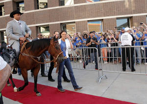photo - Charles Barkley rides a horse to the TNT set before game three of the Western Conference Finals in the NBA playoffs between the Oklahoma City Thunder and the San Antonio Spurs at Chesapeake Energy Arena in Oklahoma City, Thursday, May 31, 2012. Photo by Sarah Phipps, The Oklahoman
