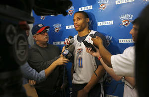 Photo - Oklahoma City's Russell Westbrook (0) talks to the media at the Thunder practice facility, Saturday, April 20, 2013, in Oklahoma City. Photo by Sarah Phipps, The Oklahoman