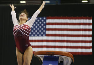 Photo - Oklahoma's Madison Mooring scored a 9.85 on the vault during Friday night's Perfect 10 Challenge at the Cox Convention Center.  Photo by Nate Billings, The Oklahoman