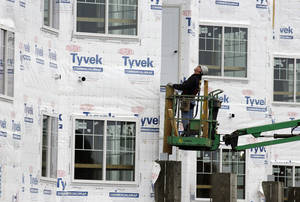 photo - In this Friday, Jan. 11, 2013 photo, a construction worker works at a new home under construction in Chicago. U.S. homebuilders began work at a slower pace in January, though the level was still the third-highest since 2008. The pace of building was viewed as a sign of further strengthening in residential real estate. (AP Photo/Nam Y. Huh)
