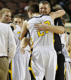Photo - Arnett coach Allen Tune hugs his son Tyler Tune during the Class B boys state championship game between Coyle and Arnett in the State Fair Arena at State Fair Park in Oklahoma City, Saturday, March 2, 2013. Photo by Bryan Terry, The Oklahoman