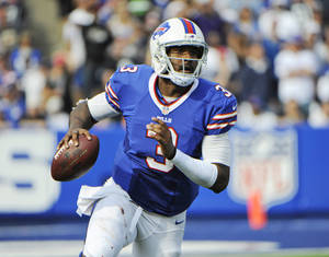 Photo - FILE - In this Sept. 29, 2013 file photo, Buffalo Bills quarterback EJ Manuel (3) looks to pass against the Baltimore Ravens during the second half of an NFL football game in Orchard Park, N.Y. The Bills rookie quarterback on Monday, Nov. 4, 2013, declared himself ready to return after missing four weeks with a sprained right knee. All that's standing in Manuel's way is a green light from coach Doug Marrone. (AP Photo/Gary Wiepert, File)