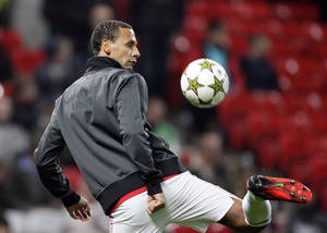 Photo -   Manchester United's Rio Ferdinand warms up prior to the Champions League Group H soccer match against SC Braga at Old Trafford in Manchester, England, Tuesday Oct. 23, 2012. (AP Photo/Jon Super)