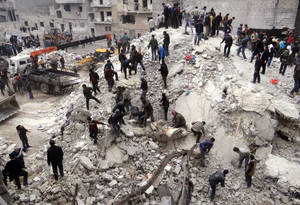 photo - This citizen journalism image provided by Aleppo Media Center, AMC, which has been authenticated based on its contents and other AP reporting, shows people searching  through the debris of destroyed buildings after airstrikes hit the neighborhood of Eastern Ansari, in Aleppo, Syria, Sunday, Feb. 3, 2013. The Britain-based activist group Syrian Observatory for Human Rights, which opposes the regime, said government troops bombarded a building in Aleppo&#039;s rebel-held neighborhood of Eastern Ansari that killed over 10 people, including at least five children. (AP Photo/Aleppo Media Center, AMC)