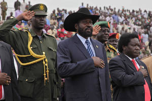 Photo -   President Salva Kiir, centre, arrives at the John Garang Masoleum in Juba, Sudan, Friday, April 27, 2012, as he is welcomed back to the country by his supporters after an official visit to China. South Sudan and Sudan have clashed for the past three weeks over the disputed border town of Heglig.(AP Photo/Michael Onyiego)