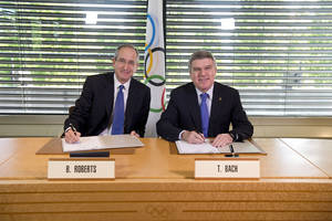 Photo - In this photo released by the International Olympic Committee (IOC), IOC President Thomas Bach, right, and Chairman and CEO of Comcast Corporation Brian L. Roberts pose for a photograph as they sign an agreement to secure the U.S. broadcast rights to the Olympics through to 2032 for NBC Universal, in Lausanne, Switzerland, Wednesday, May 7, 2014. NBC secured the U.S. broadcast rights to the Olympics through 2032 on Wednesday in a record six-games deal worth $7.75 billion. NBC already holds the rights through the 2020 Olympics in a four-games deal signed in 2011 for $4.38 billion. (AP Photo/Arnaud Meylan)