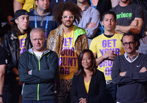 Photo - US rapper Redfoo, centre, watches as Victoria Azarenka of Belarus receives her trophy after defeating China's Li Na in the women's final at the Australian Open tennis championship in Melbourne, Australia, Saturday, Jan. 26, 2013. (AP Photo/Andrew Brownbill)