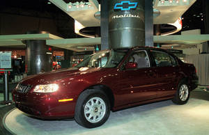 """Photo - File-This March 27, 1997, file photo shows 1998 Chevrolet Malibu at the media preview of the New York International Automobile Show.  General Motors' safety crisis worsened on Monday, June 30, 2014, when the automaker added 8.2 million vehicles to its huge list of cars recalled over faulty ignition switches. The latest recalls cover seven vehicles, including the Chevrolet Malibu from 1997 to 2005 and the Pontiac Grand Prix from 2004 to 2008. The recalls also cover a newer model, the 2003-2014 Cadillac CTS. GM said the recalls are for """"unintended ignition key rotation."""" (AP Photo/Ed Bailey, File)"""