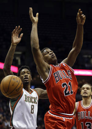 Photo -   Milwaukee Bucks' Larry Sanders (8) knocks the ball away from Chicago Bulls' Jimmy Butler (21) during the first half of an NBA basketball game, Saturday, Nov. 24, 2012, in Milwaukee. (AP Photo/Morry Gash)