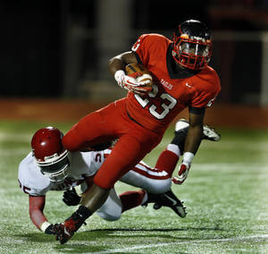 Photo - Duncan's Styacee Morrison tries to stop Del City's Anthony Mason in high school football on Friday, Nov. 1, 2013 in Del City, Okla.  Photo by Steve Sisney, The Oklahoman