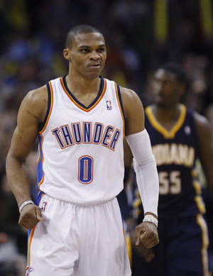 Photo - Oklahoma City Thunder guard Russell Westbrook (0) react after hitting a shot against the Indiana Pacers in the fourth quarter of an NBA basketball game in Oklahoma City, Sunday, Dec. 9, 2012. Oklahoma City won 104-93. (AP Photo/Sue Ogrocki) ORG XMIT: OKSO108