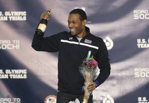 Photo - Shani Davis celebrates smiles on the podium after winning the men's 1,500 meters during the U.S. Olympic speedskating trials Tuesday, Dec. 31, 2013, in Kearns, Utah. (AP Photo/Rick Bowmer)